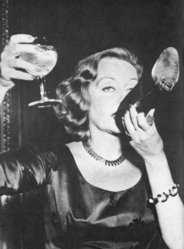 Tallula Bankhead drinking champagne out of her shoe at The Ritz, 1951
